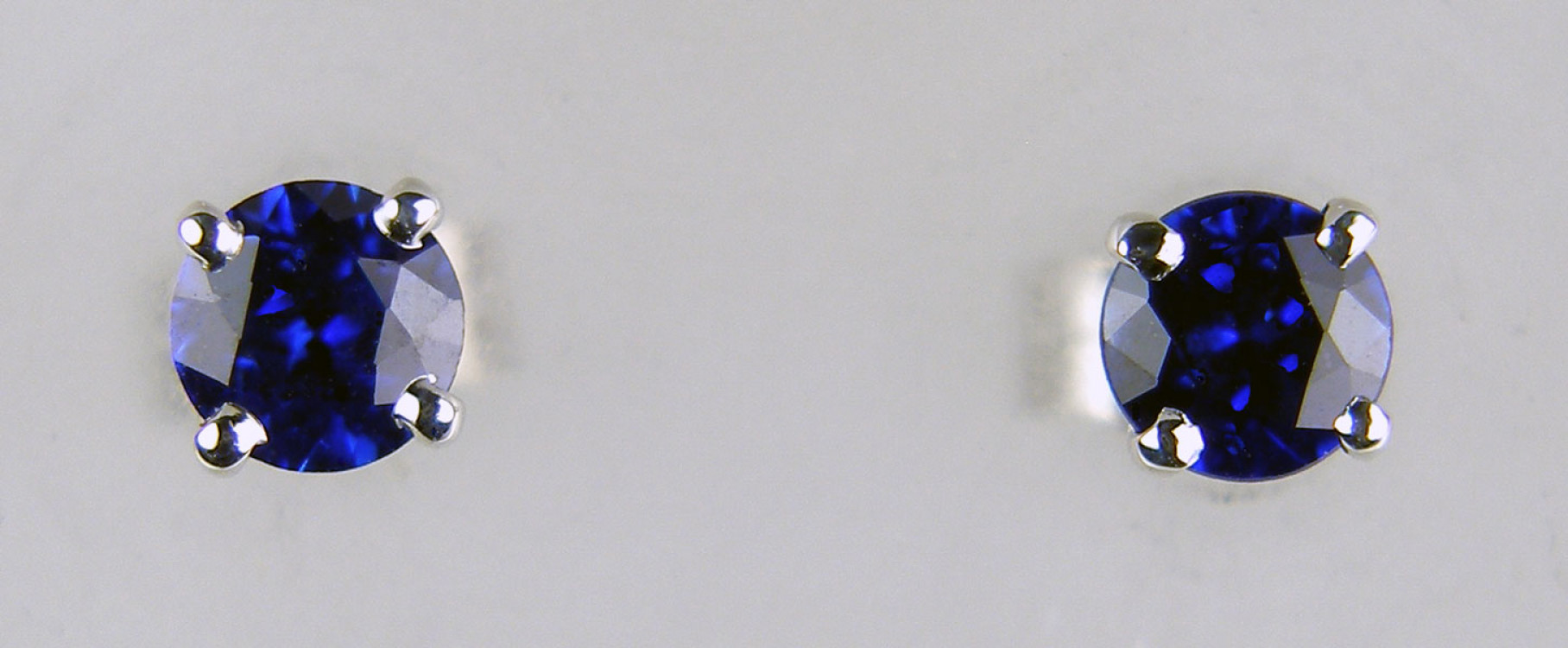 d11e3fcc4 4mm sapphire earstuds in 9ct white gold - 0.67ct round cut royal blue  sapphires mounted
