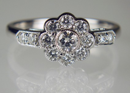 Diamond cluster ring in 18ct white gold - 0.60ct G/VS clarity brilliant cut diamonds set as a flower shaped cluster ring in 18ct white gold on an 18ct white gold shank