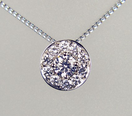 "Diamond slider pendant in 18ct white gold - 0.78ct of round brilliant cut diamonds of G colour SI clarity mounted in 18ct white gold and suspended from an 18ct white gold 16"" chain.  Beautiful, simple and super sparkly. Pendant is 10.5mm in diameter."