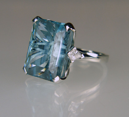 Aquamarine & diamond ring in platinum - 17.85ct aquamarine cut by Thoma Trozzo, stone of exceptionally fine colour and quality, flanked by a 0.34ct pair of kite cut diamonds in E colour VVS clarity, mounted as a ring in platinum