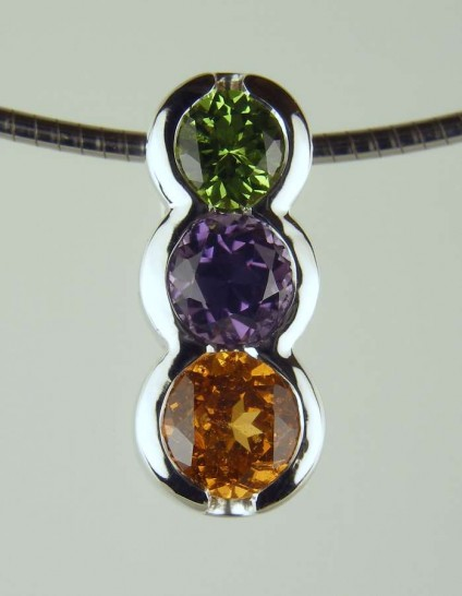 """Tricolour Pendant - 4.5mm tsavorite (4.5mm), 0.66ct purple spinel (5mm), 0.91ct mandarin garnet (5.5mm) set in 18ct white gold, suspended from an 18"""" 18ct white gold chain"""