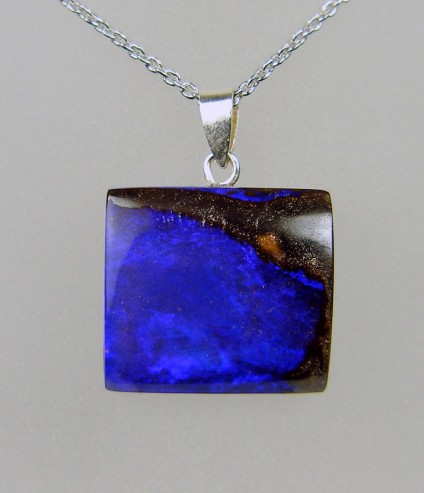 32.06ct boulder opal pendant in silver - Vivid blue boulder opal with simple silver bail, 19 x 17mm, on adjustable silver chain.
