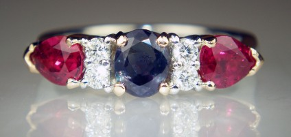 Alexandrite, ruby & diamond ring in platinum - 0.61ct oval alexandrite, 4 x 2.1mm round brilliant cut diamonds in G/VS, total diamond weight 0.15ct, and a 1.09ct matched pair of pear cut natural rubies. The shank and diamonds are mounted in platinum