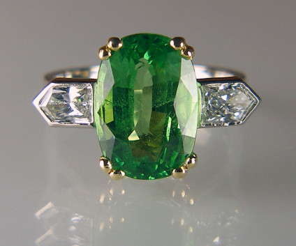 Tsavorite & diamond ring - 5.66ct cushion cut tsavorite garnet set with 0.70ct bullet cut diamond pair in G colour VS2 clarity and mounted in an 18ct white and yellow gold ring