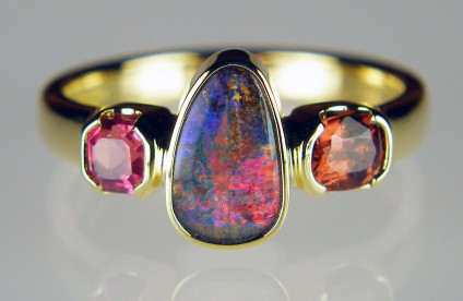 Boulder opal, spinel & ruby birthstone ring - Striking ring made with family birthstones and set with a Queensland boulder opal (October), a 0.48ct cushion cut brown Burmese spinel (August) and a 0.42ct ruby octahedron (July), all mounted in 18ct yellow gold