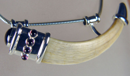Boar's tusk pendant set with garnets in silver - Unusual commission!  Medieval boar's tusk set in silver with cabochon garnets.