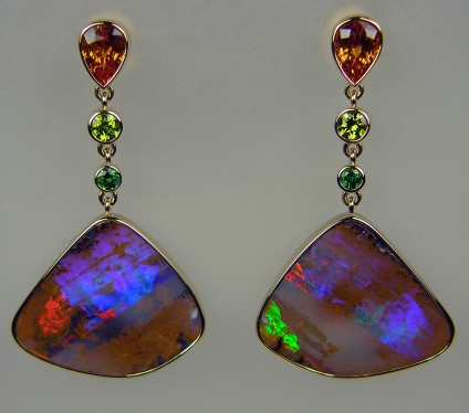 Boulder opal, orange & green garnet earrings in 18ct yellow gold - Exceptional matched pair of boulder opals weighing 31.77ct, from Queensland, Australia, set with 2.34ct spessartine orange garnet trillion pair and 0.40ct tsavorite garnet round pair in pale green and a 0.19ct pair of tsavorite garnets in an intense green. All mounted in 18ct yellow gold.  The finest earrings we have ever made! They are 42mm long.