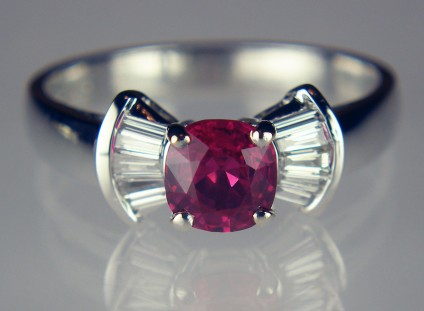 Burmese ruby and diamond ring in 18ct white gold - Exquisite, bright and very clean, Burmese cushion cut ruby 0.85ct set with 0.26ct of tapered baguette cut diamonds in 18ct white gold ring. This is a beautiful ring, Helen Plumb bought the ruby in Myanmar in 2017.