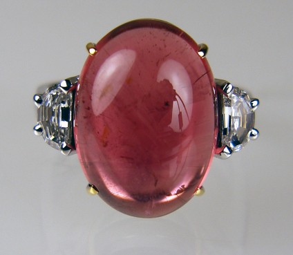 Cabochon tourmaline ring - Superb 15.50ct cabochon cut red tourmaline set with 0.55ct pair of G colour VS1 clarity half moon cut diamonds, mounted in 18ct white & yellow gold.