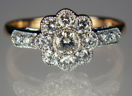 Diamond cluster ring in rose & white gold - 0.60ct total diamond weight cluster ring. Set with G colour VS clarity diamonds in 18ct white gold with an 18ct rose gold shank.