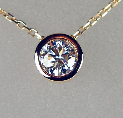 1/2 carat diamond slider pendant in 18ct rose gold - 0.50ct G/VS round brilliant cut white diamond, rubover set in 18ct rose gold and suspended from a delicate 18ct rose gold chain