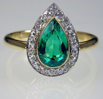 Emerald & diamond ring in gold - Emerald and diamond ring set in 18 carat gold and platinum. 1.03ct emerald with 0.4ct diamonds in G colour VS1 clarity. Ring head is 18 x 11mm. An independent pre-sale report by Adrian Smith of Perth estimates the high street value of this ring at £5250.