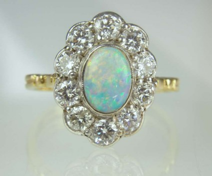 Opal & diamond ring - Estate piece. 0.75ct white opal set with 1.12ct diamonds in 18ct white & yellow gold.