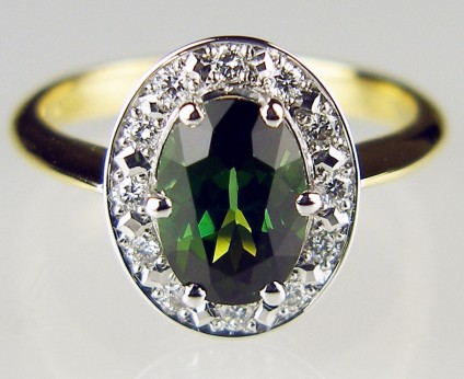 Tourmaline & diamond cluster ring - 1.62ct oval green tourmaline surrounded by 0.21ct of F colour VS clarity diamonds mounted in 18ct white and yellow gold