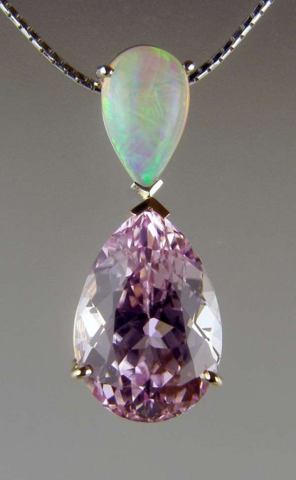 "Kunzite & opal pendant - 8.78ct pear cut kunzite, set with 1.42ct pear cut cabochon Ethiopian opal, in 18ct white gold, suspended from 16"" 18ct white gold anaconda chain"