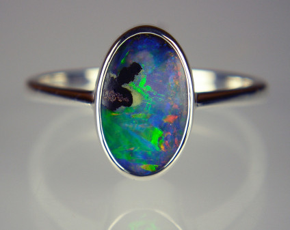 Boulder opal ring in silver - Sweetly simple little boulder opal from Queensland set in a rubover silver ring