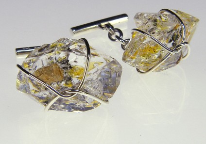 Oil included quartz cufflinks in gold - Cufflinks of natural doubly terminated quartz crystals with hydrocarbon inclusions, from Baluchistan, mounted in 9 carat white gold. Available in a range of sizes.