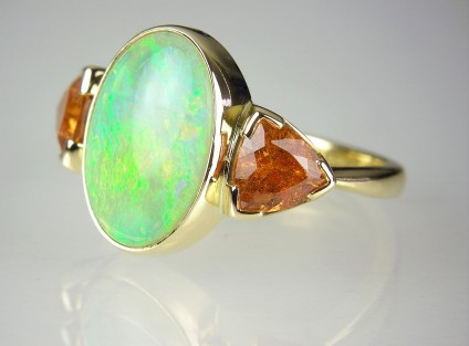 Opal & spessartine garnet ring in gold - Mandarin garnet & white opal ring in 18ct yellow gold set with 2.75ct oval cabochon cut opal & 2.06ct trillion cut spessartine (mandarin) garnets.