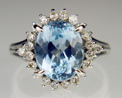 Oval aquamarine & diamond ring in platinum - 3.84ct oval aquamarine mounted with 0.46ct of G colour VS clarity round brilliant cut diamonds in platinum ring