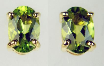Peridot earstuds in 9ct yellow gold - 0.93ct oval peridot pair set in 9ct yellow gold. Peridots are 6x4mm