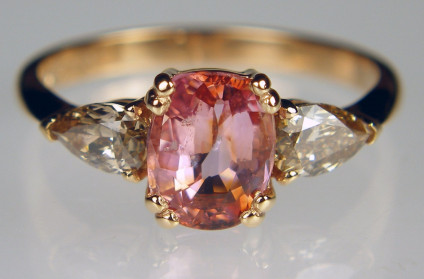 Padparadscha sapphire & cinnamon diamond ring - Rectangular cushion cut 1.48ct peach pink sapphire flanked by a 0.51ct pair of pear cut brown diamonds mounted in 18ct rose gold ring