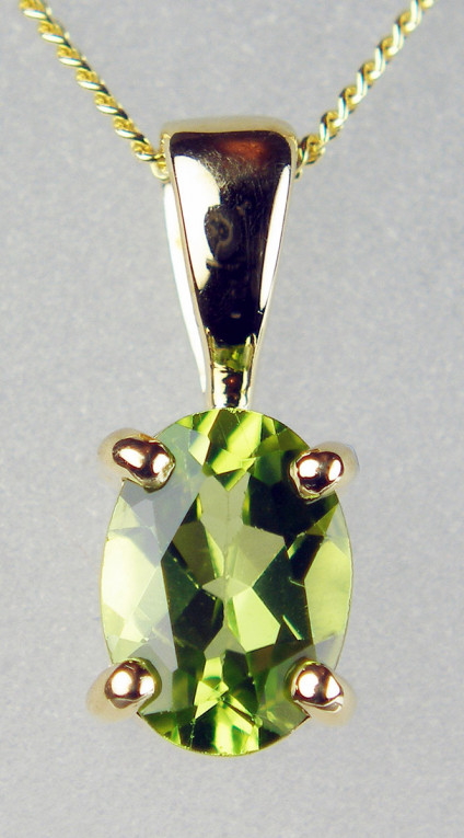 """Peridot pendant in 9ct yellow gold - 7x5mm oval peridot 0.77ct in 9ct yellow gold, suspended from an 18"""" 9ct yellow gold chain"""