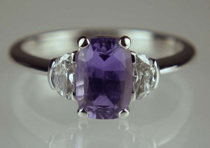 Lilac sapphire & diamond ring - 1.54ct rectangular cushion cut lilac sapphire set with 0.25ct half moon diamond pair in GH colour SI clarity, mounted in 18ct white gold