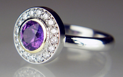 Purple sapphire halo ring - Remodel of client's own sapphire and diamonds. Making a silk purse out of what can only be described as a sow's ear!  Check out the Just Gems Facebook page to see more. We do a fabulous job of remodelling other goldsmith's mistakes.