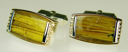 Rutilated quartz cufflinks - Glossy and elegant rutilated quartz cabochon pair set in silver & 9ct gold as cufflinks. Cufflinks measure 22 x 13mm.