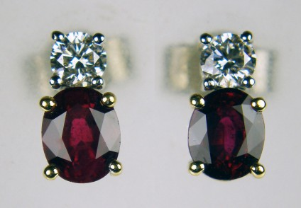 Ruby & diamond stud earrings - 0.92ct oval ruby pair set with 0.20ct of G/VS quality diamond rounds in 18ct yellow & white gold