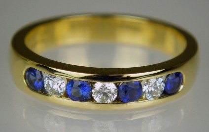 Sapphire & diamond half eternity ring in 18ct yellow gold - 0.37ct sapphires & 0.21ct diamonds set in 18ct yellow gold. Ring size N - this ring cannot be adjusted for size.