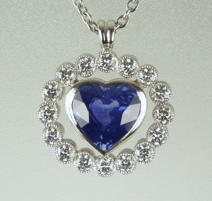 Sapphire heart pendant - 1.34ct heart cut sapphire set with 0.3ct round brilliant cut diamonds in 18ct white gold