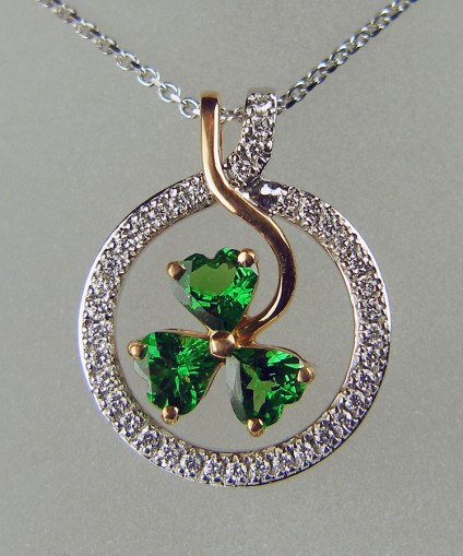 "Shamrock pendant in rose gold - Exquisite pendant set with 1.27ct of heart cut green tsavorite garnets and 0.26ct of F colour VS clarity round brilliant cut diamonds, mounted in 18ct rose and white gold and suspended from a 16"" 18ct white gold chain"