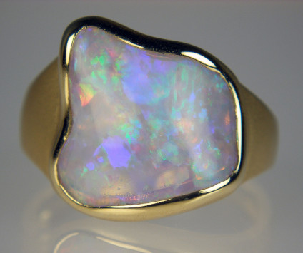 Australian crystal shell opal set in 18ct yellow gold ring - 2.22ct polished domed crystal opal from Coober Pedy, Australia, the replaced shell of an ancient bivalve, mounted in 18ct yellow gold brushed and polished gold ring
