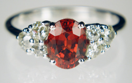 Spinel & diamond ring in 18ct white gold - 2.06ct oval red spinel set with a cluster of old cut diamonds on each shoulder (customer's own), mounted in 18ct white gold