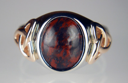Man's signet ring with Scottish jasper, in palladium and Irish rose gold - Another bespoke creation from Just Gems, a melding of Scottish and Irish elements, with a St Cyrus jasper and hematite cabochon sourced by Adam MacIntosh, set in a stout palladium mount with Celtic knots on the shoulders made using Irish rose gold