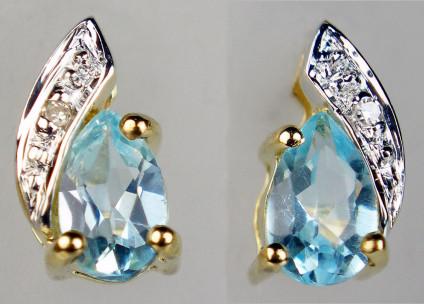 Aquamarine & diamond earstuds in 9ct yellow gold - Delicate aquamarine pearcuts set with brilliant cut shite diamonds in 9ct yellow gold. Earstuds are 8mm long.
