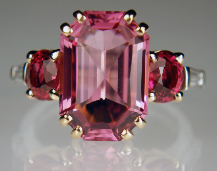 Pink & red spinel & diamond ring in platinum & rose gold - 5.41ct fancy cut pink spinel flanked by a 1.20ct pair of oval cut red spinels and a futher 0.38ct pair of G/VS tapered baguette cut diamonds. The spinels are set in 18ct rose gold and the diamonds and ring shank are in platinum