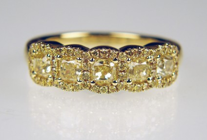 Yellow diamond 5 stone cluster ring in 18ct yellow gold - 5 matched yellow diamonds weighing 0.97ct and surrounded by 0.28ct of small brilliant cut round yellow diamonds in 18ct yellow gold ring.  If you like rich and vibrant gold, this shimmering confection is for you!